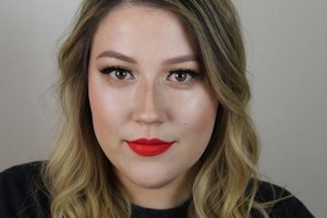 It's a simple, glowing special occasion makeup look using glittery eyes and red lips. I put the look together on my Youtube channel linked below :)