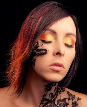 Matching hair and makeup, I think my mom looks beautiful! Vibrant colors!! This is my mom last year in a photo shoot she was in last year, natural black hair, no bleach work for the red and orange in her hair!!
