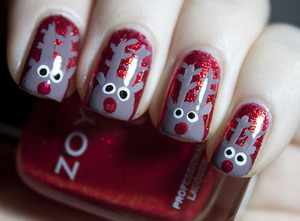 Rudolph reindeer mani!  Polishes Used- Base color-China Glaze-Ring in the Red Rudolph's face, ears & antlers-Zoya-Jana His red nose-Zoya-Lisa & for his eyes I used  Sinful Colors-Snow me White & Wet n Wild Black Creme.  I used a dotting tool and a nail ar