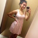 Lace dress, bun, iphone