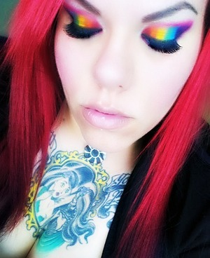rainbow eyes and red hair