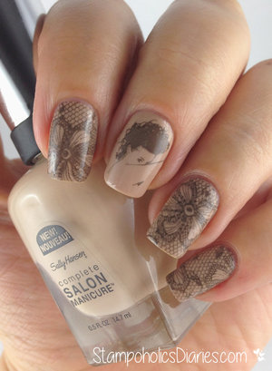 http://stampoholicsdiaries.com/2014/11/29/sally-hansen-shore-enough-and-midnight-in-ny-with-stamping-mm-44-ls-03/