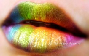 Rainbow lips... The mineral eyeshadows I used to create this look ended up being a private label product being sold as handmade, so I will not promote or give out the name of said company. With a little looking around my blog though, it's pretty simple to figure out who it was! Anywho- it's simply black kohl eyeliner I lined my lips with, brushed and faded inwards, and color applied and slightly blended to give it a gradient look :)