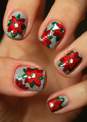 Poinsettias are a quintessentially holiday thing to me, and everything is better with glitter and rhinestones!  http://www.dressedupnails.com/2012/12/the-digit-al-dozen-does-festiveness-day.html