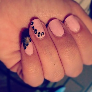 I was just playing around with my nails and did leopard on one nail and a diagonal half and half on another.