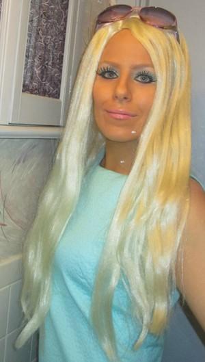 Malibu Barbie for Halloween..fake lashes, wig, and 3 coats of fake tan =)