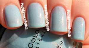 This is a gorgeous light blue polish that has pink and orange glass flecks. It's seriously magical. More pictures can be seen on my blog!