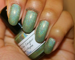 Two coats of Liquid Sky Lacquer Autumn Thyme, plus topcoat. A sage green holo. ♥_♥  Freakin' gorgeous.