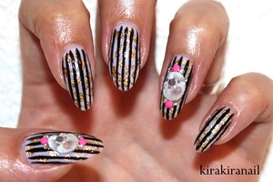 """Tutorial: http://www.youtube.com/watch?v=MVnwtgBUy0c  ♡ Products I used ♡  """"pro white, rosé"""" by essence """"Black Swan"""" by L'Oreal Color Riche (black) Nail Art Foil:  http://www.bornprettystore.com/nail-foil-gold-silver-decoration-glitter-p-272.html   Water Decals: http://www.bornprettystore.com/butterfly-rose-flower-skull-water-decals-nail-stickers-p-5310.html  (Nr.6) Studs: http://www.bornprettystore.com/200pcbag-neon-round-stud-rhinestone-acrylic-nail-colors-p-6494.html  Crystals from Studio Nail (rakuten.com) Base and top coat"""