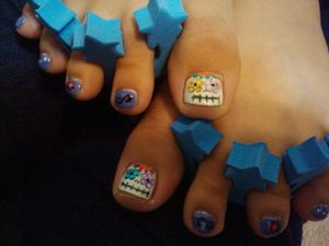 Sugar skull toes on my daughter ( and they're glow in the dark) =)