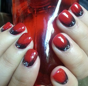 Red gel polish is a perfect base color for a black halo using pure pigment.