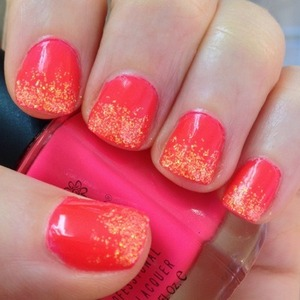 I wanted to create a glitter gradient to go with Color Club's Jackie OH! So I chose Eye Kandy's Tangerine Twist sugar and mixed it into a Revlon clear lacquer and make a custom manicure. Jackie OH! comes out a lot more orange on the nail and under Seche Vite than it does in the bottle but I really love the neon, bright effect of this manicure.  http://michtymaxx.blogspot.com.au/2013/01/twist-on-jackie.html