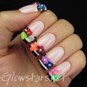 Read the blog post at http://glowstars.net/lacquer-obsession/2014/10/black-white-striped-french-and-3d-acrylic-flowers/