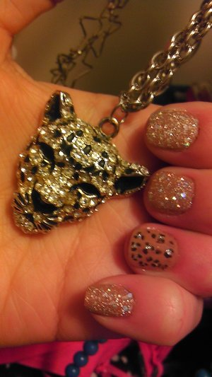 """I just love this Mani. I Used the new Zoya pixie dust polish in """"BAR"""" and base color from Opi in """"San Tan-tonio"""", black spots were done with the black sally Hanson nail pen."""