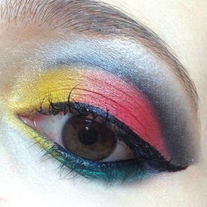 This is the inspired look for the Guns n' Roses gig I went to a few weeks ago, so I created this EOTD based on their logo. I used Sugarpill @#$%! and Buttercupcake with Asylum and Goldilux over the top for some shine and some greens like Midori and UD Graffiti for the rose element and for the guns I used some silver and slate Inglot shades. http://www.michtymaxx.blogspot.com.au/2013/04/inspired-guns-n-roses-eotd.html