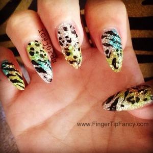 FOR DETAILS GO TO: http://fingertipfancy.com/multi-print-animal-nail-tutorial  TUTORIAL: http://www.youtube.com/watch?v=w_K142oYHaU