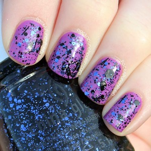 Bling It On is a purple and black glitter polish. It's part of the Glitz Bitz 'N Pieces Collection. This is one coat over China Glaze Gothic Lolita with a coat of Out The Door top coat.  Full Blog Post: http://www.packapunchpolish.com/2013/01/china-glaze-bling-it-on-swatches.html