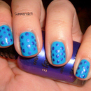 Blue and purple dotted nails