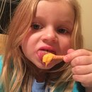 Kyleigh eating cheese and pretzels