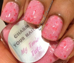http://www.polish-obsession.com/2013/04/charm-your-nails-my-twirly-tutu.html