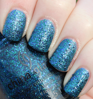 Water You Waiting for is a medium/dark blue glitter polish. It has fine blue and green glitter as well as larger blue glitter. It's part of the Cirque du Soleil: Worlds Away Collection. This is 2 coats without top coat.