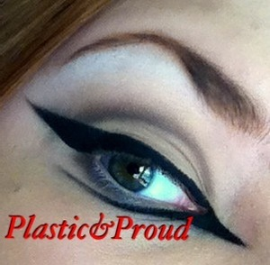 Some concept makeup I was working on. I know the photo is edited, but the shape of the eyeliner is what I was going for the most, and it was taken on an iPod, so not the greatest quality. :)