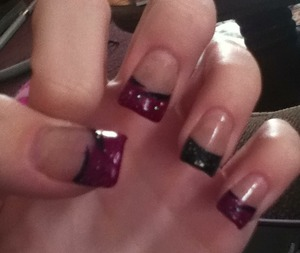 I did my own acrylics and painted all my tips purple and left my ring finger tip black. I also put sparkles over them and added a black swish underneath :)