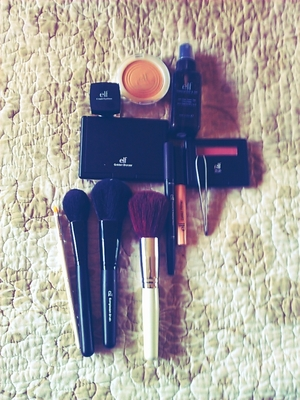 Today's makeup haul from e.l.f consisting of brushes, bronzer, blush, pressed powder, defining eyeliner, professional tweezers, makeup set spray, primer and a smokey shadow/eyeliner pen.   All for $30!