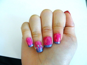 Hi! This is a photo of a princess nail design. Its something girly due to the pink and purple color. I added crystals for the crown (: