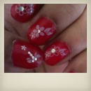 red painted nails with flowery designs!