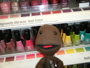 Took my son's Sackboy shopping with me, he knows my favorite section, nails and makeup lol.