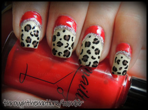 Ruffian Leopard!  Trying out Nailtini's Bloody Mary <3 (It's actually not as bright as it is in the photo)  Colors Used: Nailtini .:. Bloody Mary, American Apparel .:. California Trooper, Avon .:. Touch of Taupe, Migi Nail Art pen .:. Black, and Sinful Colors .:. Nail Art Fashionista