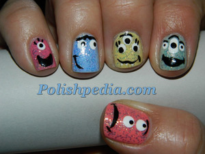To see this full design, including the products we used to create it, please visit http://polishpedia.com/monster-skittles-manicure.html