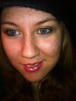 Light brown smokey eye with bold pink, glossy lips