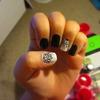 Black, white, and silver nail design