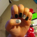 Black, white, and silver nail design