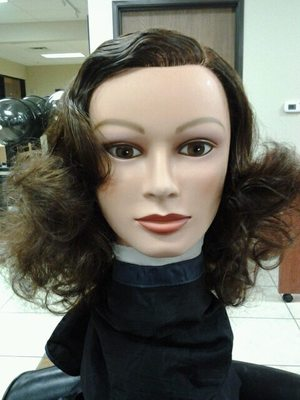 finger wave and pin curls combed out front