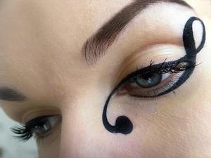 http://missbeautyaddict.blogspot.com/2012/04/make-up-challenge-creative-eyeliner.html