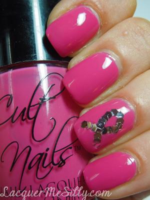 Breast Cancer Awareness Mani using Cult Nails Devious Nature and individually placed large silver hex glitters for the ribbon.