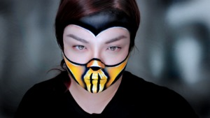 Makeup look I did of Scorpion specifically from Mortal Kombat 4 (remember for the N64?).  I don't know why Beautylish doesn't have this listed, but I primarily used Wolfe FX water-based face paints.  I topped it with Sugarpill eyeshadows.  Tutorial of this look is on my Youtube channel: http://www.youtube.com/user/Minsooky
