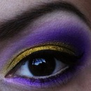 Gold and purple cut crease