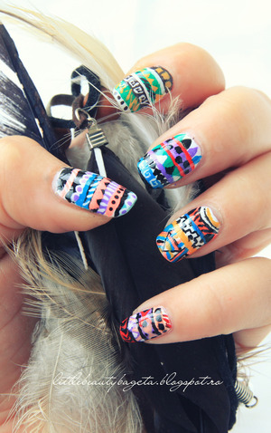more photos here: http://littlebeautybagcta.blogspot.ro/2013/01/tribal-nails-colab.html