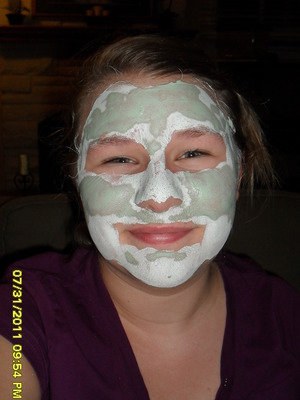 Sporting a green facial mask! hehe it's getting a little hard to smile :D