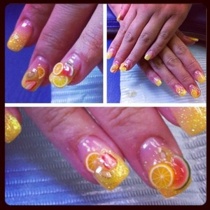 yellow base glitter faded to clear  This design is with gel, calgel, easy to replicate with polish, but would recommend doing this in gel so the fruits are raised, stay put better with gel cover as opposed to polish top coat. http://fingertipfancy.com/nutrition-fruit-nails-yum