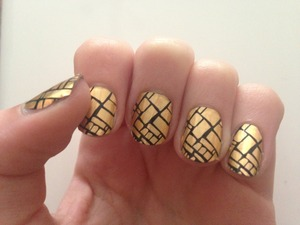 For Christmas I received a pack of technic nail foils and have been way to scared to try them.  These are a really cool gold metallic with a sort of black brick outline pattern. I found these to be very big for my nail and did have to cut all of them smaller and they are were not staying flat by the tips if my nails. Look wise thought they look awesome.  slightly scared to do my right hand now though…...