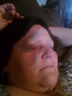 i tried to make my mom into David bowie :) it's hard to cover eyebrows completely