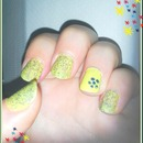 Yellow nails with blue glitter and I added a cute flower for extra cuteness :3