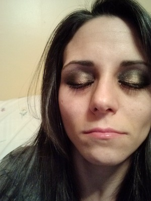 I used Oil Slick from the Urban Ammo Palette on the outer and inner corners of my eyes and Penny Lane in the middle.  Then I used Anonymous from the Vice Palette by my brow with a dusting of Maui Wowie from Urban Ammo over it.  After that, I used Smog from the Urban Ammo Palette in my crease and blended generously.  Lastly, I curled my lashes and followed that with 2 coats of Too Faced's Lashgasm Mascara.  =)