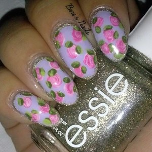 Pastel purple base with three-toned pink roses. Accented all nails with a glitter border.