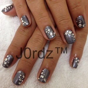 China Glaze – Awaken  Swarovski clear rhinestone, flat back-ss7, ss9, ss12  Be sure to cover with nail glue, especially over the rhinestones since this manicure has multiple stones on every nail http://fingertipfancy.com/gunmetal-topped-with-bling